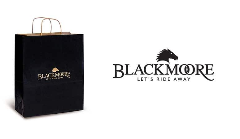 BLACKMOORE : Création du nom, baseline et logo reprenant les codes de l'équitation anglaise et du luxe avec les doubles anneaux - Agence Linéal